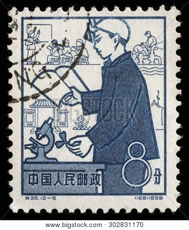 ZAGREB, CROATIA - SEPTEMBER 08, 2014: A stamp issued in the China shows Education, the 1st Anniversary of People's Communes, circa 1959.
