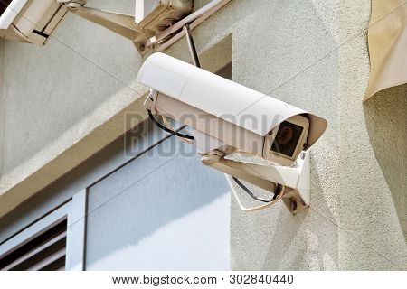 Security Camera And Reflector On The Wall Of A House And The Building, Close Up. Security Home Camer