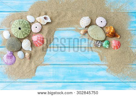 Top View Of Beach Sand With Shells. Summer Background Concept.