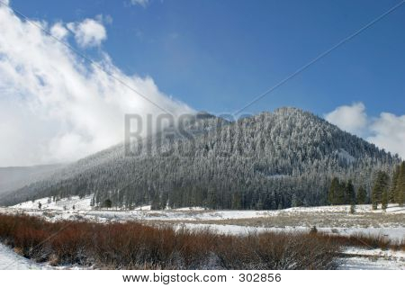 Cloud On Snowy Mountain