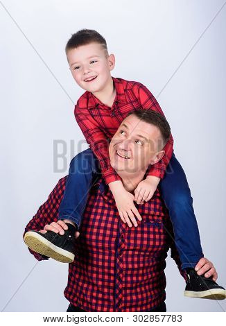 Fathers day. Father example of noble human. Father little son red shirts family look outfit. Best friends forever. Dad piggybacking adorable child. Having fun. Happiness being father of boy poster