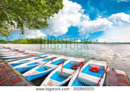 Boats In Public Garden Herastrau (king Mihai I Of Romania Park). Fantastic Sunny Morning On The Pond