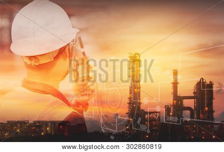 Double Exposure Of Engineer With Safety Helmet With Oil Refinery Industry Plant Background. Industri
