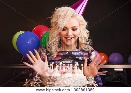 Birthday, A Young Woman Blows Out The Candles On Her Birthday Cake. Birthday Party, Joy And Fun.