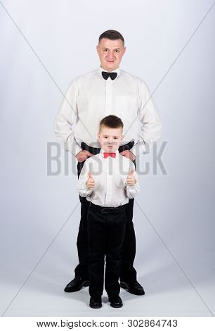 poster of esthete. male fashion. little boy with dad businessman. family day. father and son in formal suit. watchmaker concept. happy child with father. business meeting party. tuxedo style. watchmaker