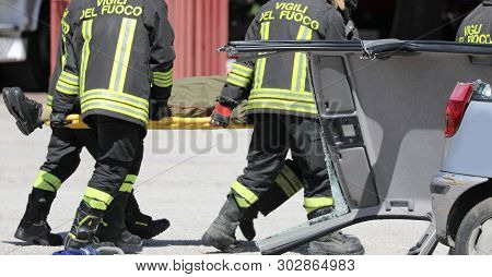 Rome, Rm, Italy - May 16, 2019: Firemen Stretcher Bearer And A Wounded Person After Road Accident