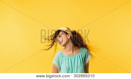 Portrait Of Easygoing, Happy Brunette Girl With Flowing Hair. Cute Emotional Lady With Delighted Fac