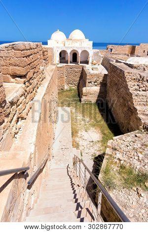 Indoor of the Borj el Kebir Castle with background of Mediterranean sea in Houmt El Souk in Djerba, Tunisia poster