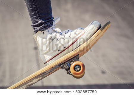 Skateboarder Legs On Skateboard At Skate Park Close Up