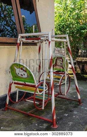 Dusun Ambengan, Bali, Indonesia - February 25, 2019: Family Compound. Small Children Swing For Two S