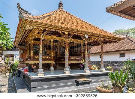 Dusun Ambengan, Bali, Indonesia - February 25, 2019: Family Compound. Open Wall Hundu Temple With La