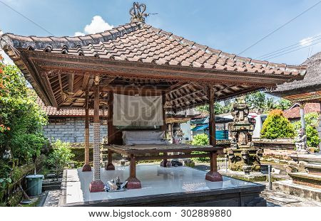 Dusun Ambengan, Bali, Indonesia - February 25, 2019: Family Compound. Open Air Bed Under Red Roof In