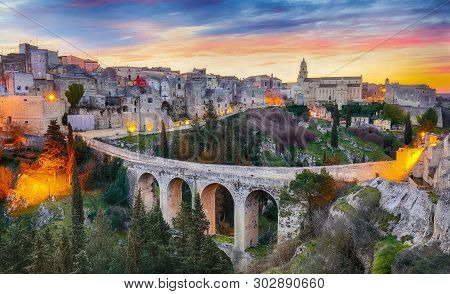 Gravina In Puglia Ancient Town, Bridge And Canyon At Sunrise. Panoramic View Of Old City Gravina In