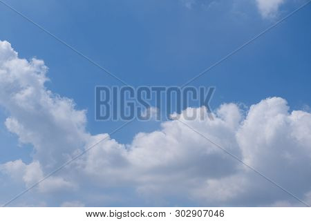 Beautiful Bright Blue Sky With White Fluffy Clouds On A Clear Sunny Day. Royalty High-quality Free S