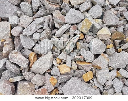 Grey Pebbles Background. Stones In Different Sizes And Shapes
