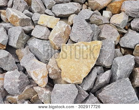 Grey Pebbles Background. Stones In Different Sizes And Shapes Backdrop.