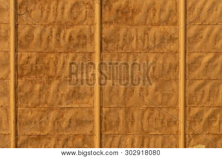 Background Texture Of Old Yellow Fence Made Of Metal Sheets