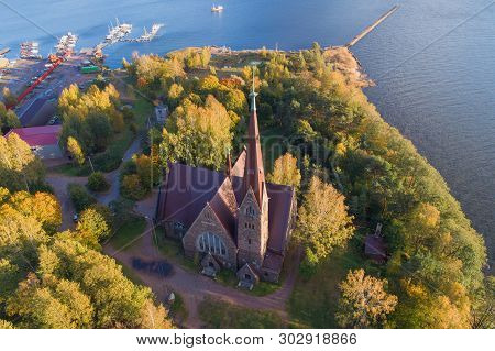 Aerial view of the old Church of Mary Magdalene on a sunny October day (aerial photography). Primorsk. Leningrad region, Russia poster