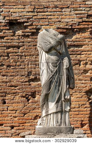 Ancient Marble Roman Statue Without Head And Toga In Ostia Antica, Colony Founded In The 7th Century