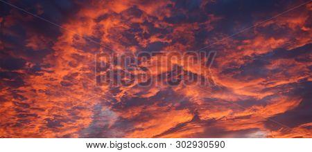 A Vibrant Inspirational Orange Coloured Altocumulus Cloudy Sunrise Skyscape. A Colourful Nature Clou
