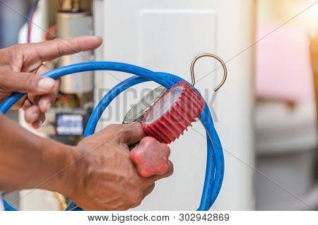 Close Up Of Air Conditioning Repair Hand Holding Pressure Gauge, Repairman On The Floor Fixing Air C