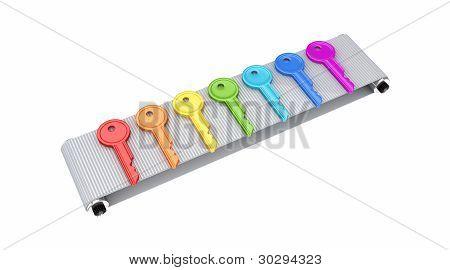 Colorful keys on grey conveyor.