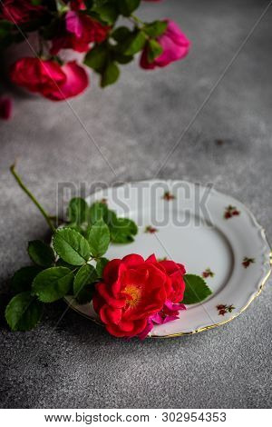 Rustic Table Setting With Rea Tea Roses On Grey Background With Copy Space