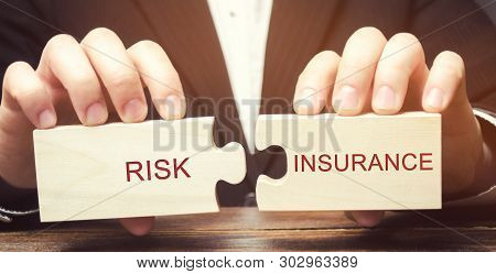 Businessman Collects Wooden Puzzles With The Word Risk Insurance. The Transfer Of Certain Risks To T