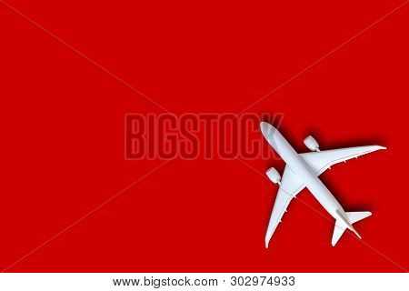 Model Plane, Airplane On Red Color Background With Copy Space, Flat Lay Design With White Plane, Tra