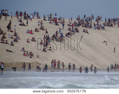 People Sitting On The Dune Of Jericoacoara To See The Sunset