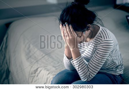 Lonely Sad Teenager Student Cry And Hug Her Knees Sitting In The Dark Corner ,sad Woman Unhappy And