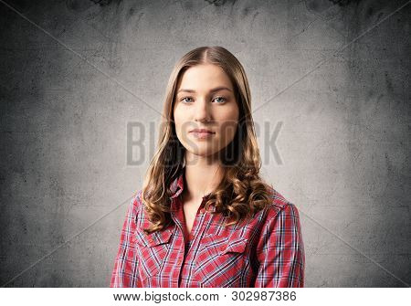 Young Woman Having Serious And Calm Face. Caucasian Female Student Has Confident Facial Expression.