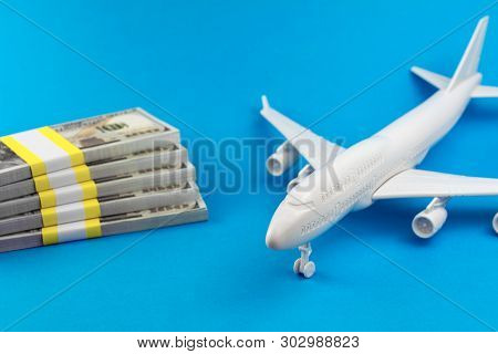 Concept Of Cheap Tickets. Cheap Trip, Searching For Low Coast Travel. Toy Airplane And Money On A Bl