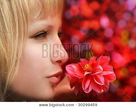 Closeup of beautiful  woman with flower