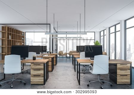 White Open Space Office With Wooden Tables