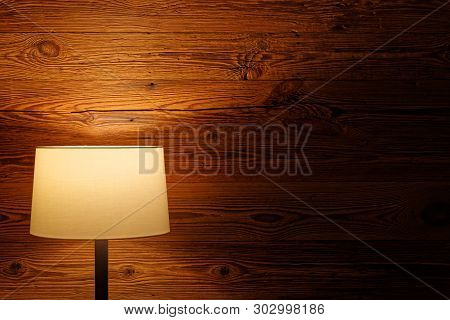 Indoor Lighting By Floor Lamp At Wooden Wall. Torfhaus, Germany