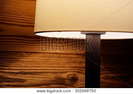 Light Of A Floor Lamp On A Wooden Wall. Torfhaus, Germany