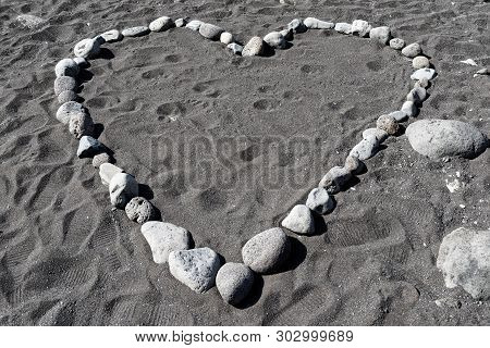 Heart Shape From Stones In Black Sand. Praia Formosa Beach In Funchal, Portuese Island Of Madeira