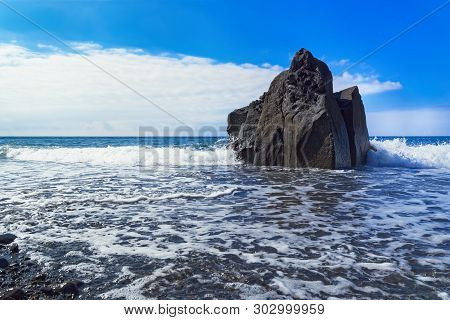 Rock Formation At The Beach Against Blue Sky. Praia Formosa Beach, Funchal, Portuguese Island Of Mad