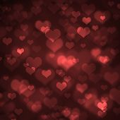 Heart-shaped bokeh on defocused background with red-black gradient. Added grain. Valentine theme. poster