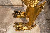 Leg of golden Guardian angel on fall cement poster