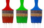 A paintbrush dripping with rgb paint isolated on white. poster