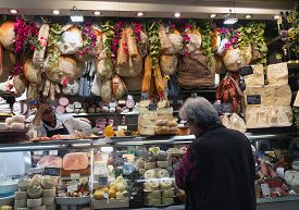 Florence/italy- April 6, 2018: Man Looking At Display With Various Italian Gourmet Meat And Cheese P