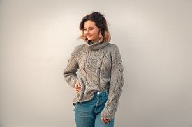 Fashion Lifestyle Portrait Of Young Trendy Woman Dressed In Brown Knit Sweater Made Of Natural Wool