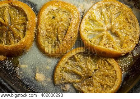 Orange In Greasy After Frying In A Frying Pan