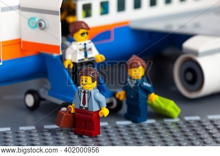Tambov, Russian Federation - January 02, 2021 Lego Businesspeople Minifigures Walking Out Of A Priva
