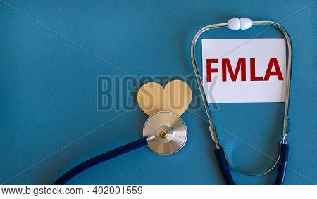 Fmla Symbol. White Card With Word 'fmla - Family Medical Leave Act' And Stethoscope On Blue Backgrou