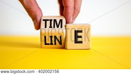 Timeline Symbol. Businessman Hand Turns Cubes With The Word 'timeline'. Beautiful Yelow Table, White
