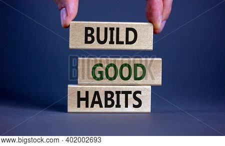 Build Good Habits Symbol. Wooden Blocks With Words 'build Good Habits'. Male Hand. Beautiful Grey Ba
