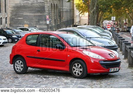 Versailles, France - September 15, 2019: Red Compact Car Peugeot 206+ In The City Street.